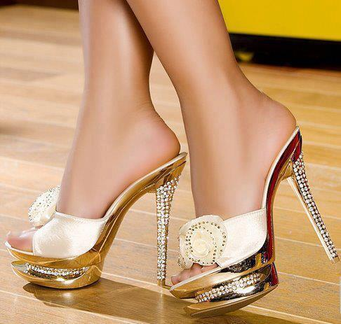 Golden high heel sandals for ladies