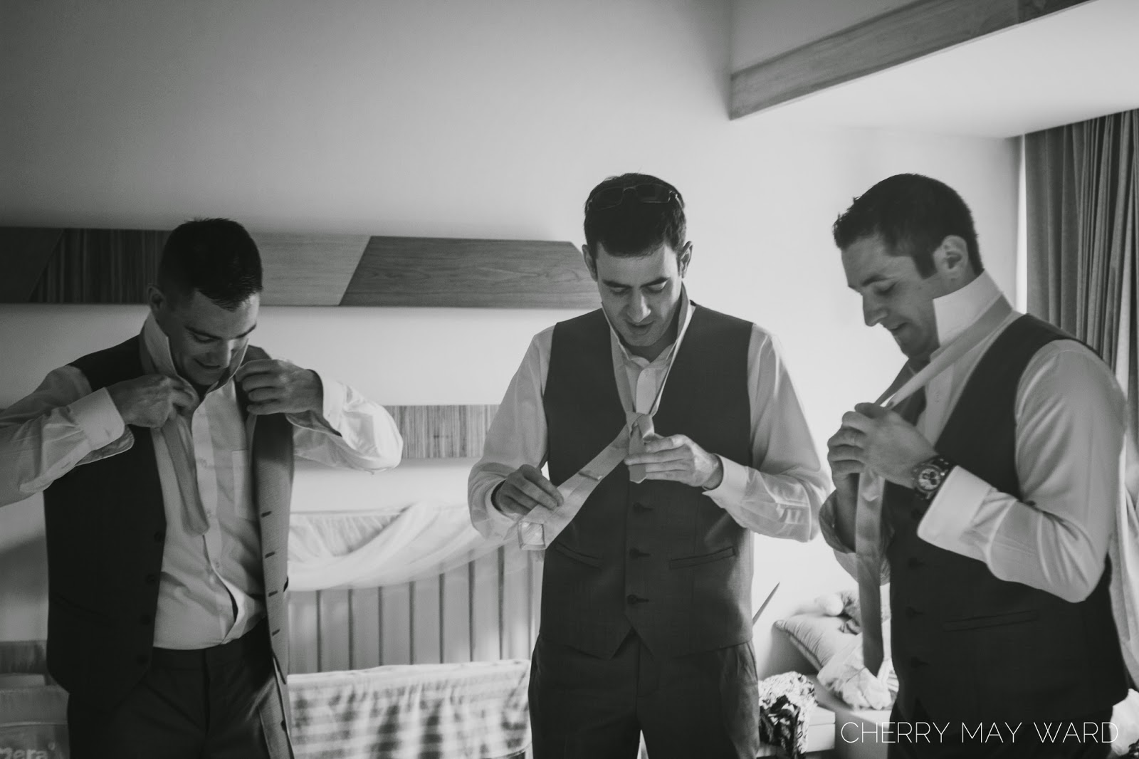 groom and groomsmen getting ready, tying ties, Thailand wedding, Koh Samui wedding photographer