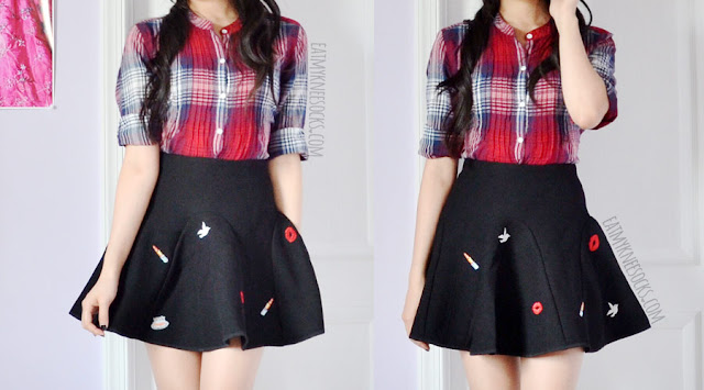 A Korean fashion inspired autumn outfit featuring a red plaid shirt and a black flared embroidered skirt/skort from Brandedkitty Shop.