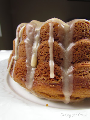 Pumpkin Bundt Cake with Browned Butter Frosting on white linen