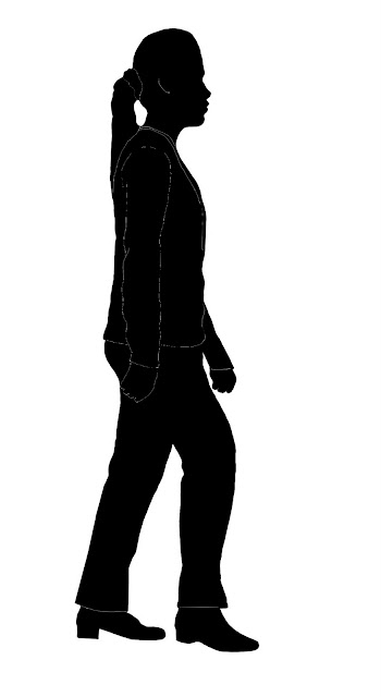 silhouette of woman in suit walking