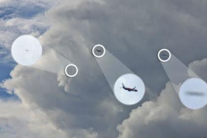 Benda Asing Diduga UFO Mengapit Pesawat Komersil