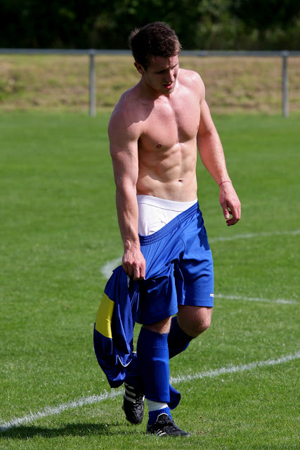 shirtless soccer player