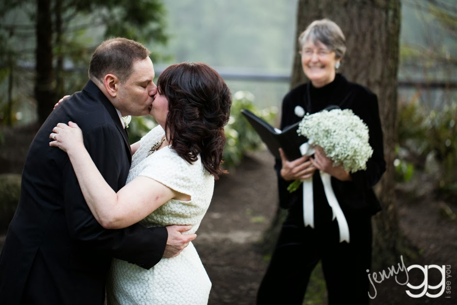 David and Linda kiss as Patricia Stimac, Seattle Wedding Officiant, looks on