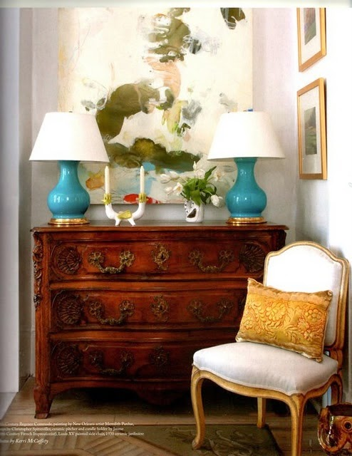 love the chest, art, turquoise lamp