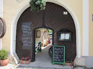 Note the bundle of green branches above the entrance of a Heuringe in Rust, Austria - it means it's openn Rust