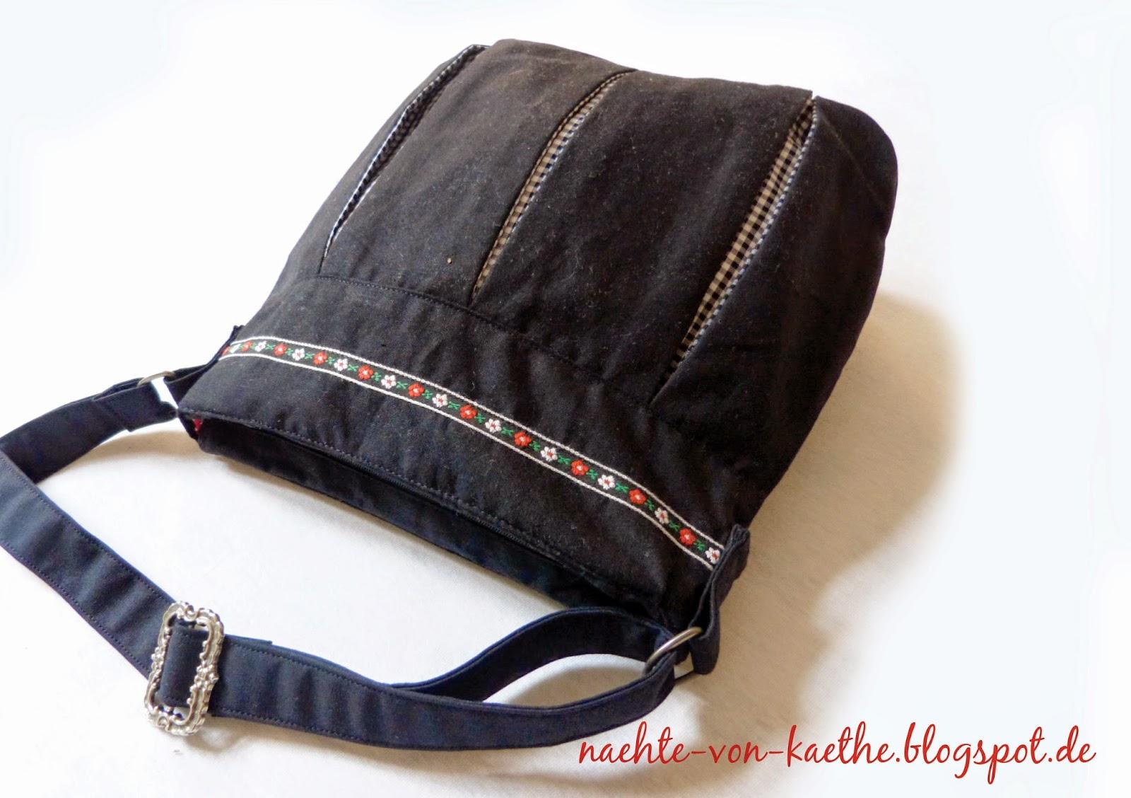 Pattydoo-Susi als Handtasche in schwarz mit Webband verziert und Reißverschluss