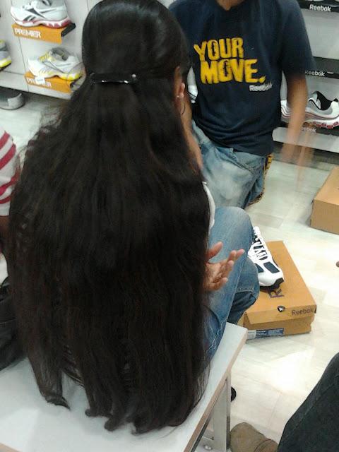loose open long hair girl in shoe mart