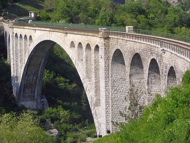 The Solkan Bridge or Ponte di Salcano is a 219.7-meter or 721 ft arch bridge over the Soca River near Nova Gorica in western Slovenia