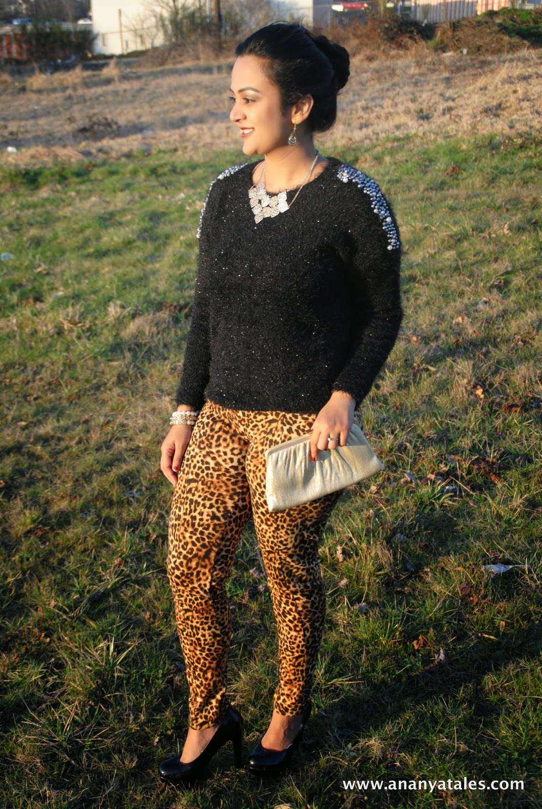 Black pumps, leopard print pants, golden accessories, golden clutch, black furry sweater