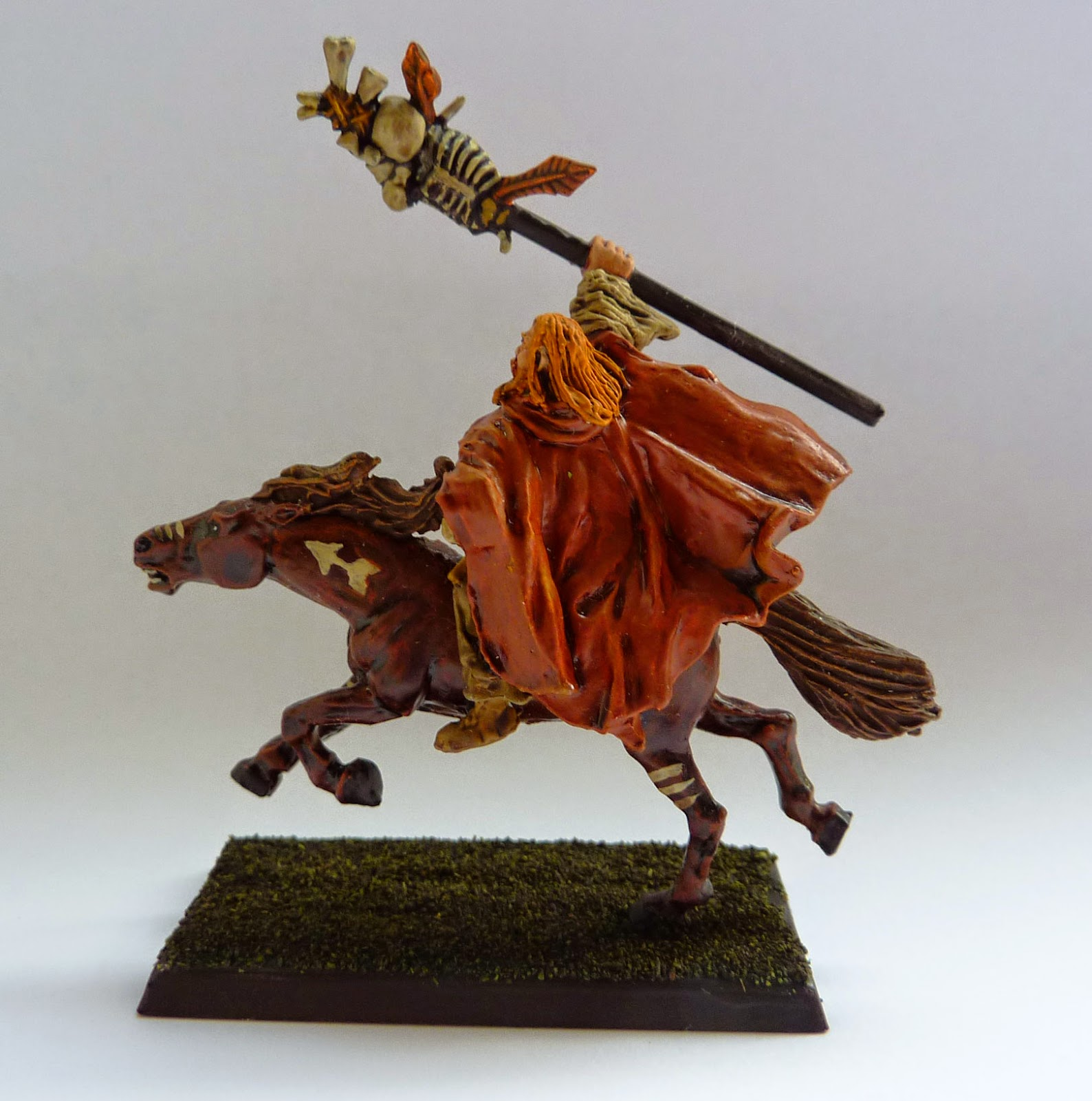 Lord of the Rings' Gandalf on Shadowfax, painted in the style of a Warhammer Empire Amber Wizard.