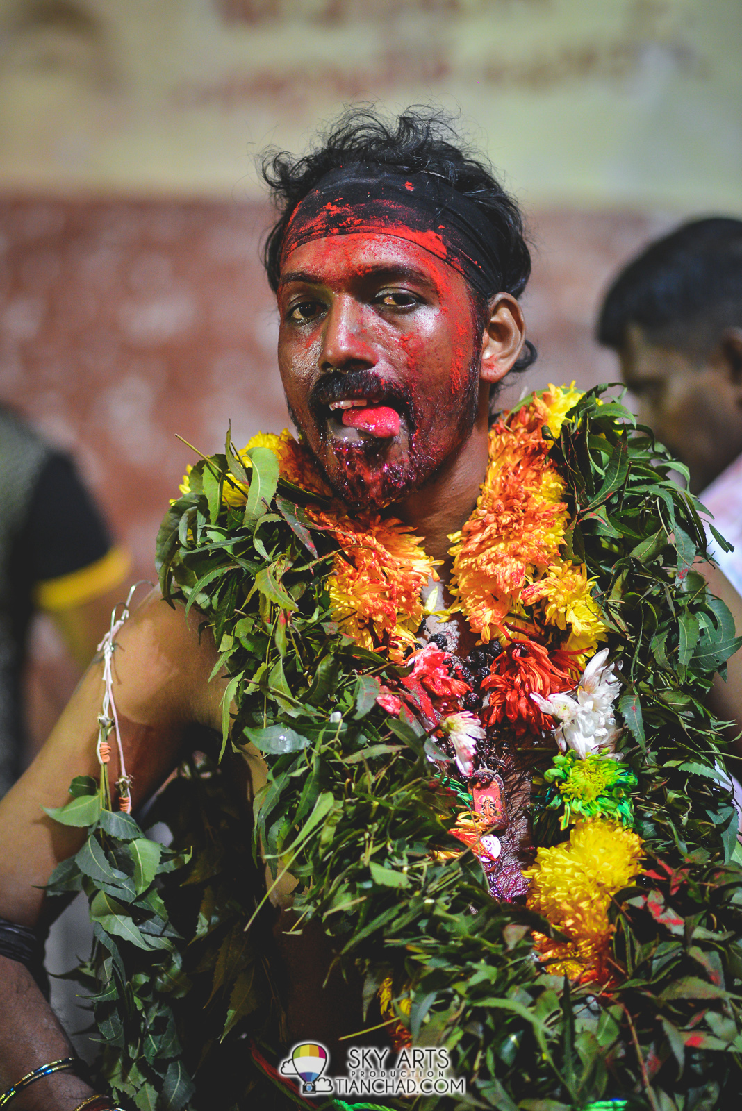 One of the devotee with red powder all over his face, not sure if it had mixed with the blood  at his chin