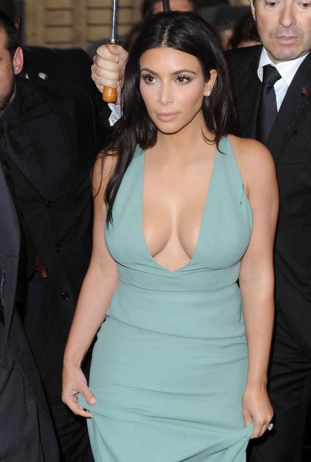 Kim Kardashian displays cleavage in a low cut gown at the ...