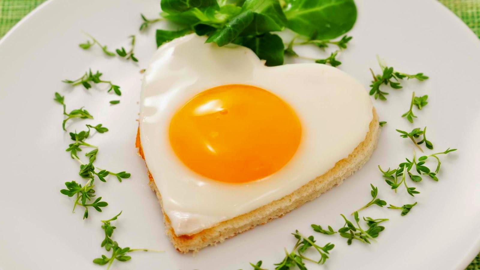 heart-shaped egg pastry breakfast