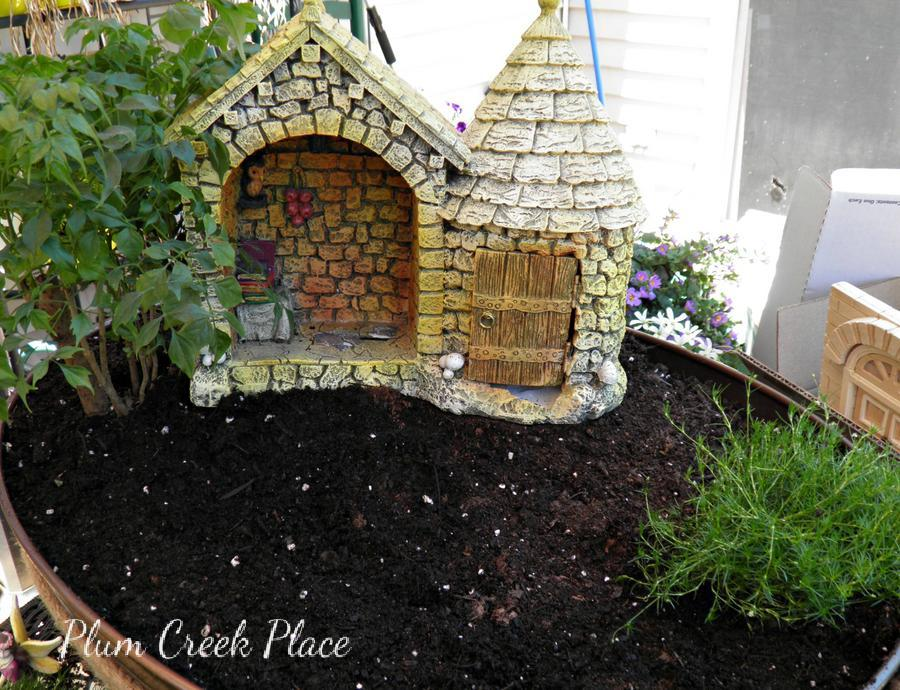 fairy garden castle. the fences and rest of plants were added after major components in place. last but not least i fairies. spent days playing with fairy garden castle a