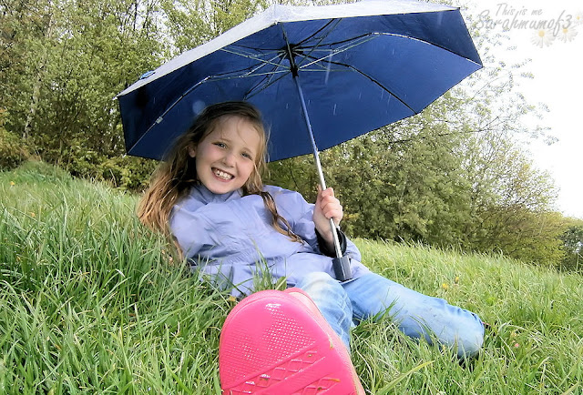 girl rain umbrella outside april showers fun