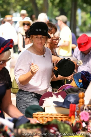 There's my girl, at the hat stall photograph