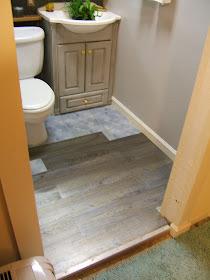 nine red: downstairs bathroom: flooring