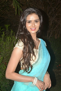 Meenakshi Dixit looks Very Cute in Open hairs Lovely Blue Saree at Thenaliraman audio launch