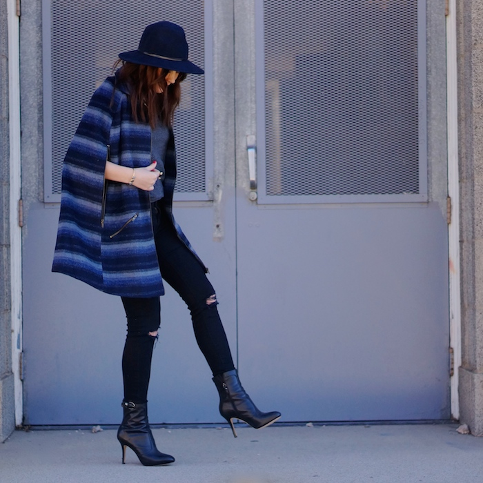 Spring casual look with a cape coat, wide brim fedora, and booties