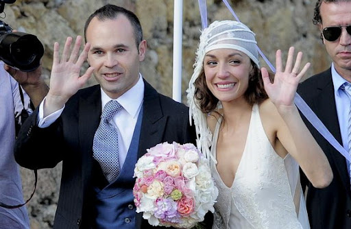 Andrés Iniesta and his wife Anna Ortiz wave to the crowd during their wedding ceremony