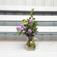 Purple flowers in jug