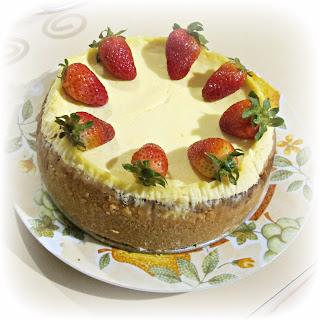 image baked lemon cheesecake strawberries