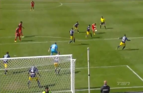 Toronto player Jonathan Osorio chips the ball from outside the box to score against Red Bulls