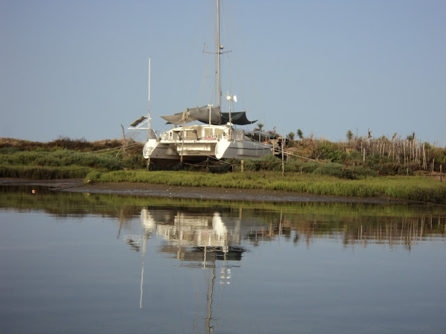 beached catamaran