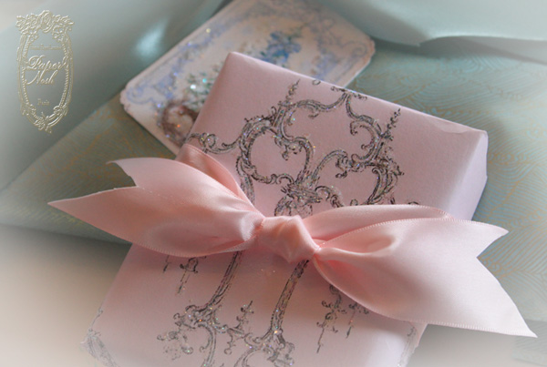 pretty wrapping paper Before tossing those wrapping paper scraps, take a look at these pretty diy decor ideas using the leftovers.