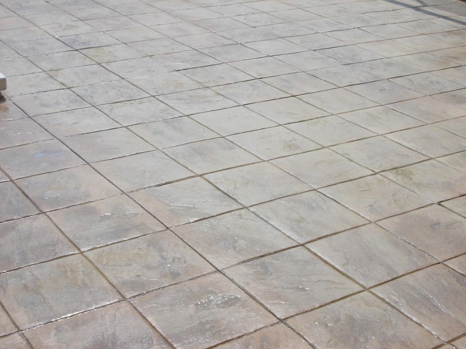 Pavimento continuo de hormig n impreso en piscina for Hormigon para pavimentos