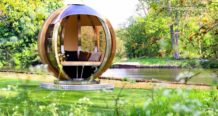 Esfera refugio de jardín con cama redonda