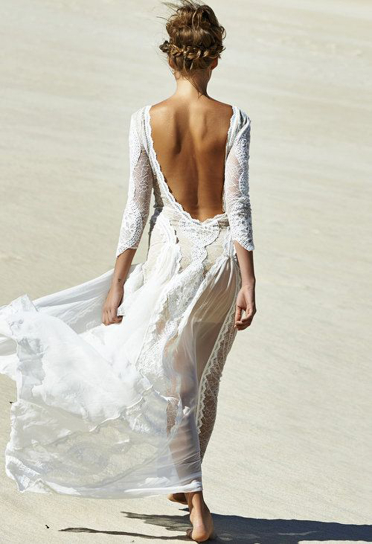 Flowy white lace backless maxi dress in the wind on the beach, romance, bridal, boho chic, flower child