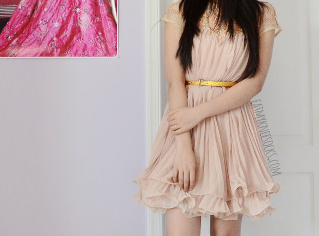 I love the ruffled hem, pleated bodice, and beaded sheer neckline details on SheIn's popular apricot shift dress.