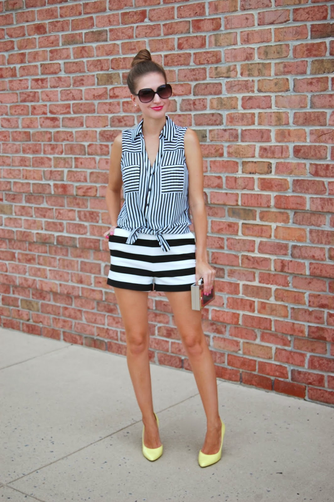 Wearing vertical and horizontal stripes. Express Striped Shorts and Express Striped Sleeveless Portofino Blouse