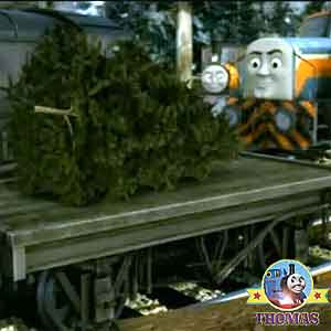 The impressive winter holiday decoration trees were rested on Thomas and friends flatbed wagon cars