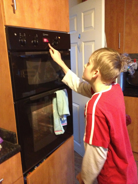 teenager using oven