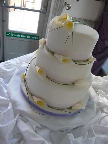 Three Tier Simple White Wedding Cake with Calla Lilies