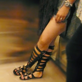 Knee-high Roman gladiator sandals.