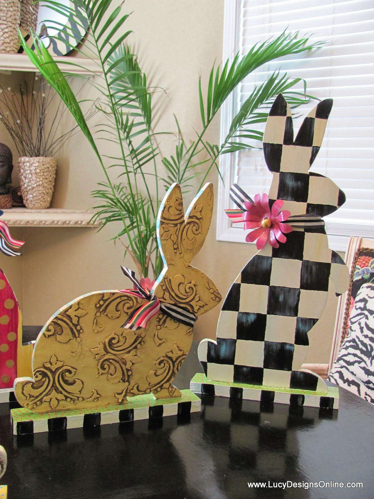 hand painted bunny rabbits with black and white checks and ribbon
