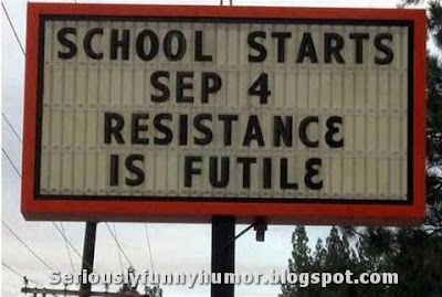 School starts, resistance is futile billboard sign