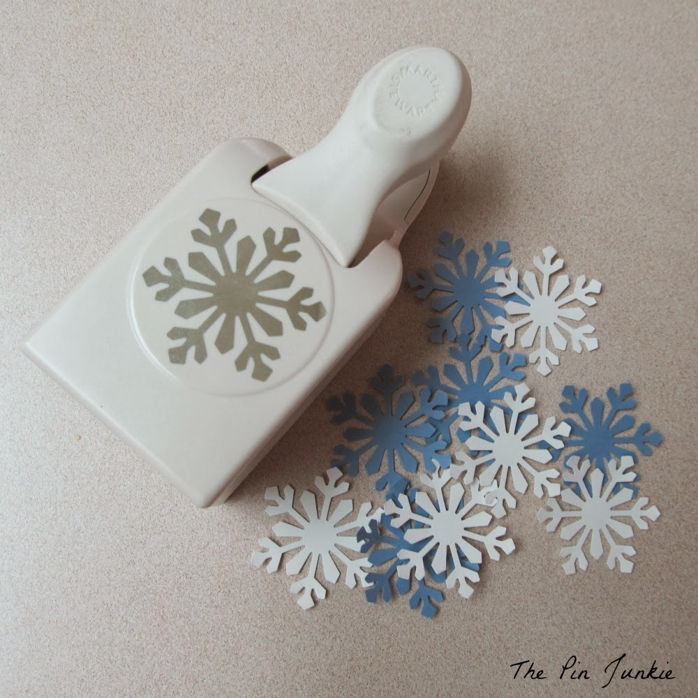 how to make snowflake ornaments out of paper