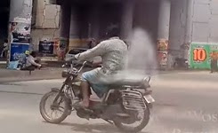 Person Riding a Bike With Ghost