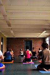 men and women in yoga class
