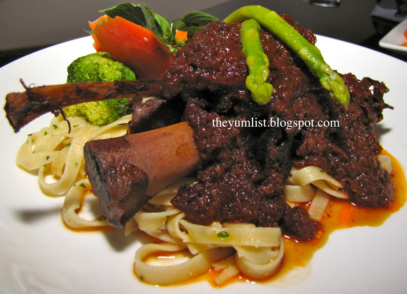 ... lamb shank fresh vegetables and pasta support a tender lamb shank