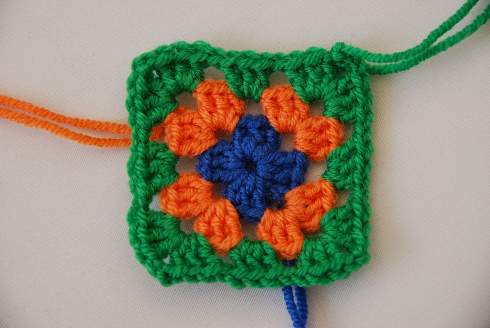 Granny square pattern tutorial: image of round 3 complete