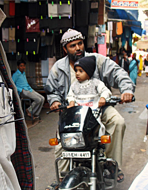 father with son on motorcycle