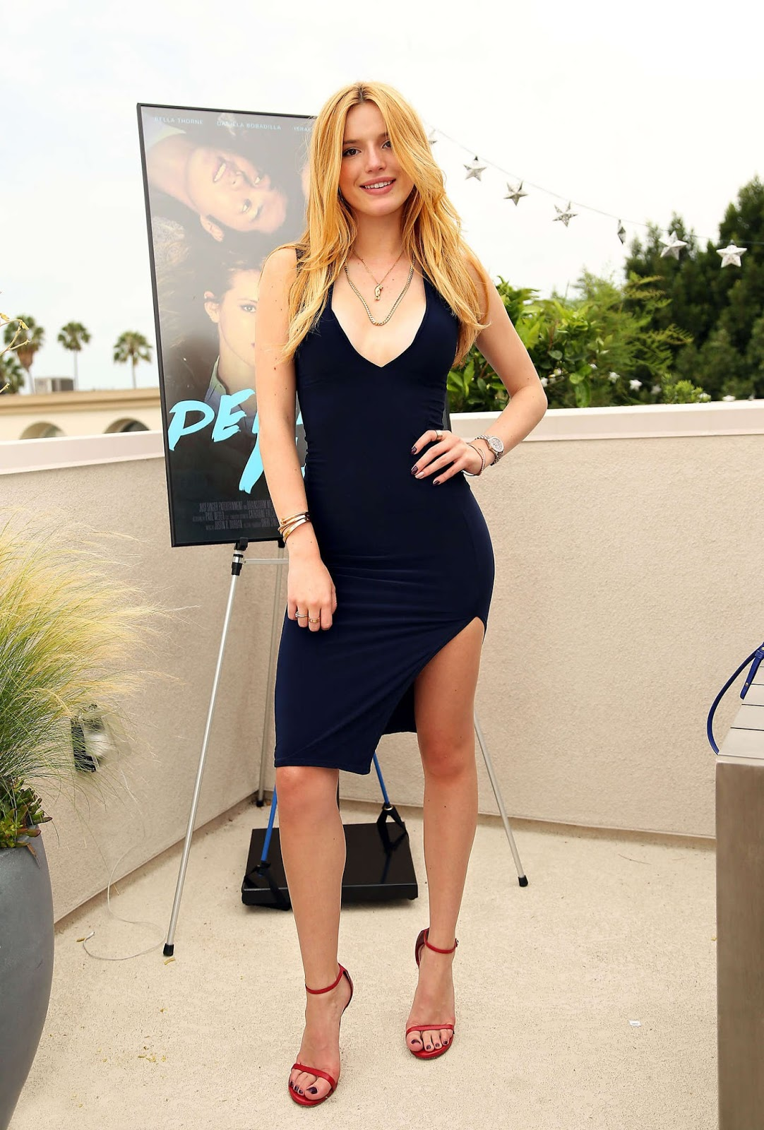 Bella Thorne in a plunging dress at the 'Perfect High' photocall in LA
