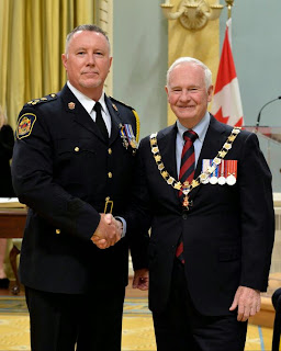 Kawartha Lakes Police Chief John Hagarty left Governor General of Canada David Johnston Right