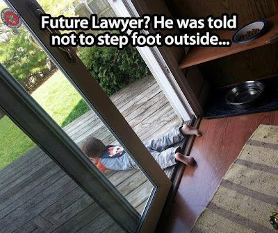 Future lawyer? He was told not to step foot outside. Boy lies on deck outside with feet still inside the door frame.